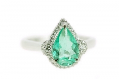 18ct white gold pear cut emerald ring featuring a diamond cluster