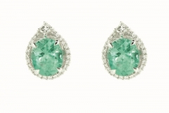 18ct white gold emerald earrings featuring a diamond halo