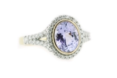 Oval tanzanite bezel set in rose gold with a diamond halo and band
