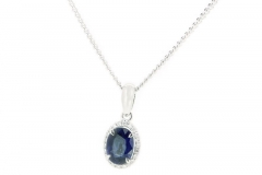 18ct sapphire pendant featuring a halo of diamonds