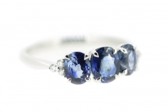 18ct white gold sapphire trilogy, featuring diamond shoulders