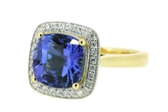 4.17ct Tanzanite ring featuring a halo of diamonds set in 18ct white and yellow gold