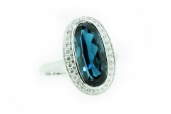 18ct white gold london blue topaz ring with diamond halo