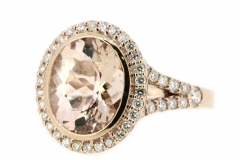 3.85ct Morganite ring featuring a diamond set slip band and halo, set in 9ct rose gold