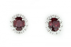Ruby studs featuring a diamond halo