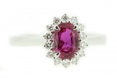 Oval cut ruby ring featuring a halo of diamonds