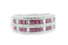 18ct white gold ring featuring princess cut rubies, round brilliant cut and emerald cut diamonds