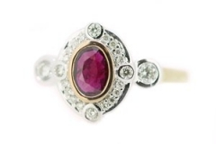 Bezel set ruby and diamond rose and white gold ring