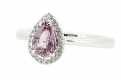Pear cut pink sapphire ring with a halo of diamonds
