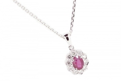 18ct white gold ruby pendant featuring a halo of diamonds