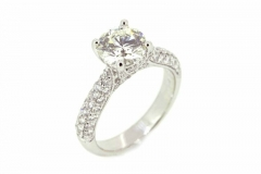 18ct White Gold solitaire featuring grain set Diamond band