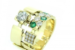 18ct yellow gold abstract dress ring featuring diamond and emerald