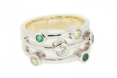 18ct two tone dress ring featuring emerald, peridot and diamond