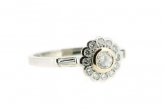 Handmade platinum and 18ct rose gold rub over diamond daisy featuring diamond bagettes