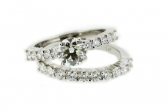 Platinum solitaire featuring diamond band and matching wedder
