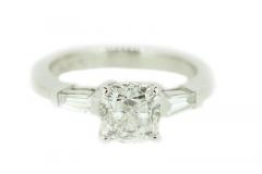 18ct White Gold engagement ring featuring tapered begettes