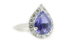 18ct White Gold Tanzanite ring featuring a diamond halo