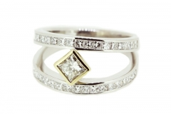 18ct two tone ring featuring a princess cut diamond and diamond set bands