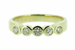 18ct Yellow Gold rub over set five Diamond band