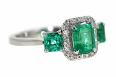 18ct trilogy style natural Emerald & a halo of diamonds