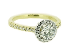 18ct yellow gold solitaire featuring diamond halo