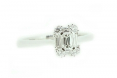 18ct white gold emerald cut engagement ring featuring a halo of diamond bagettes and four round brilliant cuts