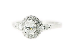 18ct white gold oval halo diamond engagement ring featuring pear cut diamond shoulderswith