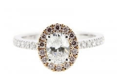 .70ct oval diamond engagement ring featuring a pink argyl diamond halo set in 18ct white and rose gold