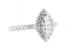 18ct white gold marquise cut diamond ring featuring a diamond halo and band