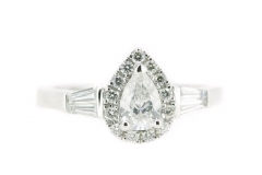 18ct white gold pear cut diamond ring featuring a diamond halo and diamond bagettes