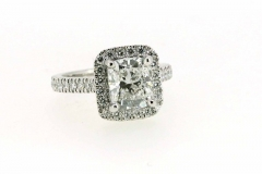Handmade platinum cushion cut engagement ring featuring a diamond halo and band