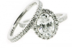 Custom Designed 1.5ct oval cut diamond, set in a halo style with matching diamond set wedding band
