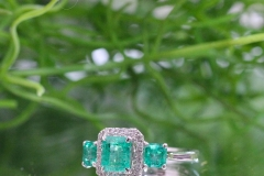 this striking piece contains 3 natural Emeralds equaling to 1.83ct, as well as 22 Diamonds equaling to .14ct, all set into 18ct White Gold