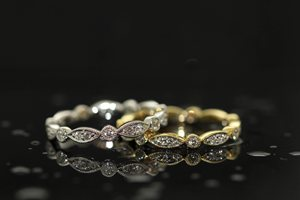 silver and gold rings with diamonds