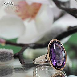silver ring with purple gem