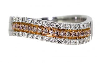 curved silver ring with diamonds