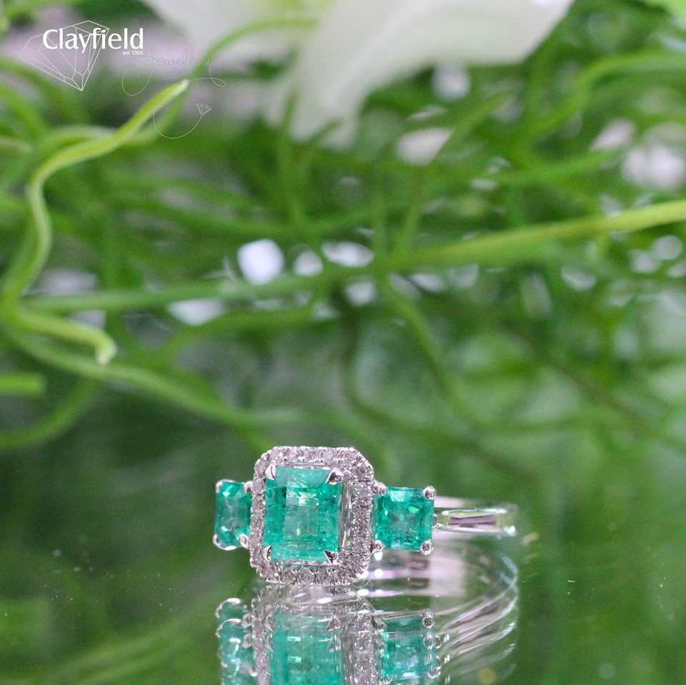 emeralds and diamonds in white gold ring
