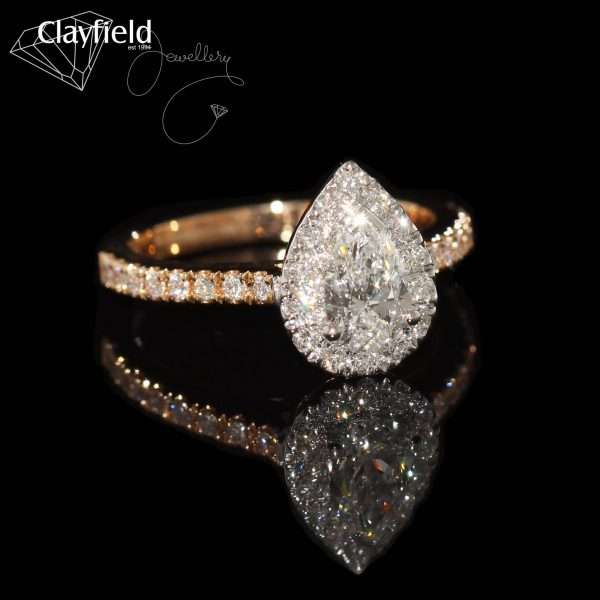 pear cut diamond ring with gold and diamond band