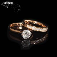 1.21ct D, Si2 Diamond Solitaire, next to a Channel set band containing 11 Diamonds equaling .40ct