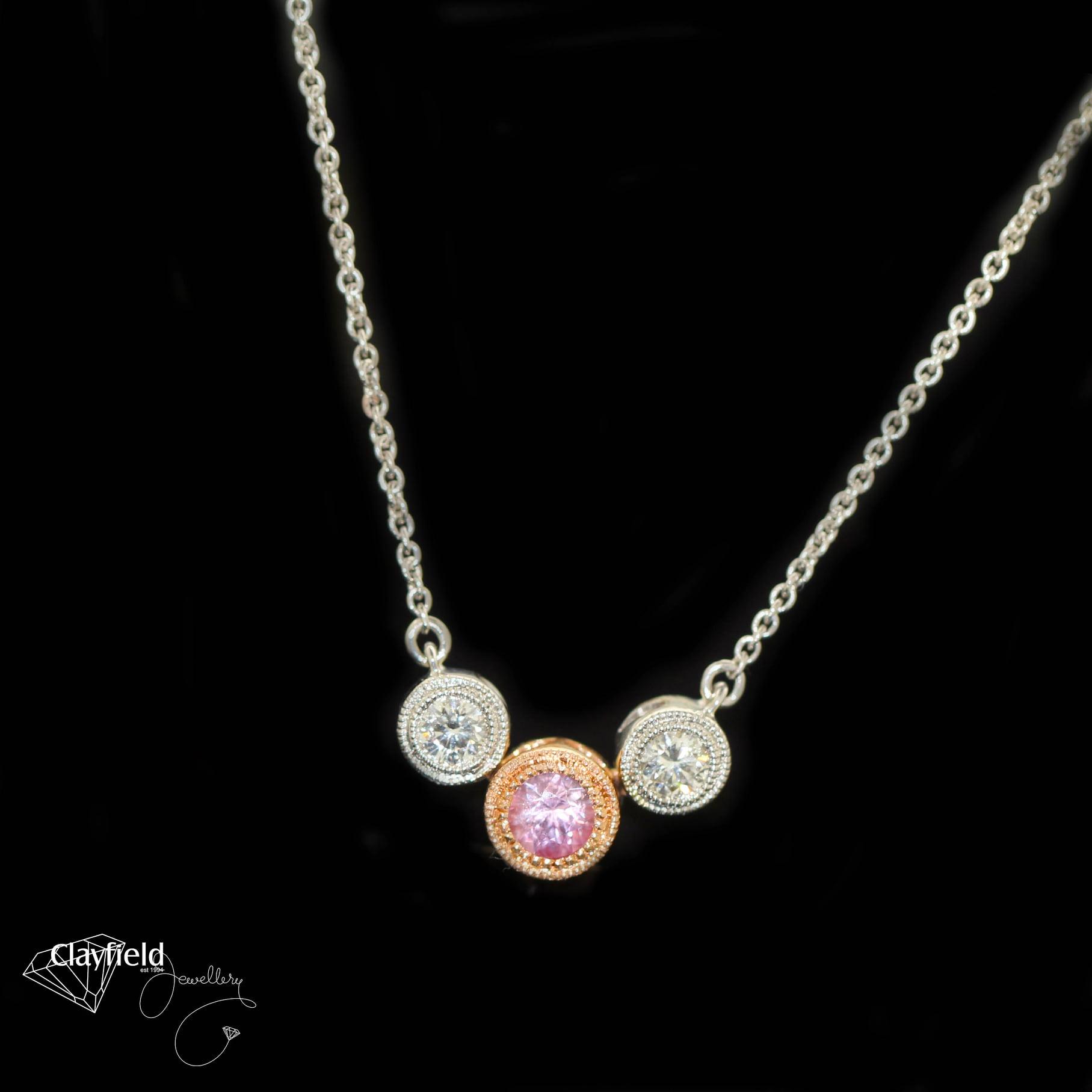 Pink Sapphire & Diamonds set into stunning 18ct Rose & White Gold