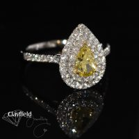 Yellow Diamond, surrounded by .61ct of Diamonds, all set into Platinum & 18ct Yellow Gold
