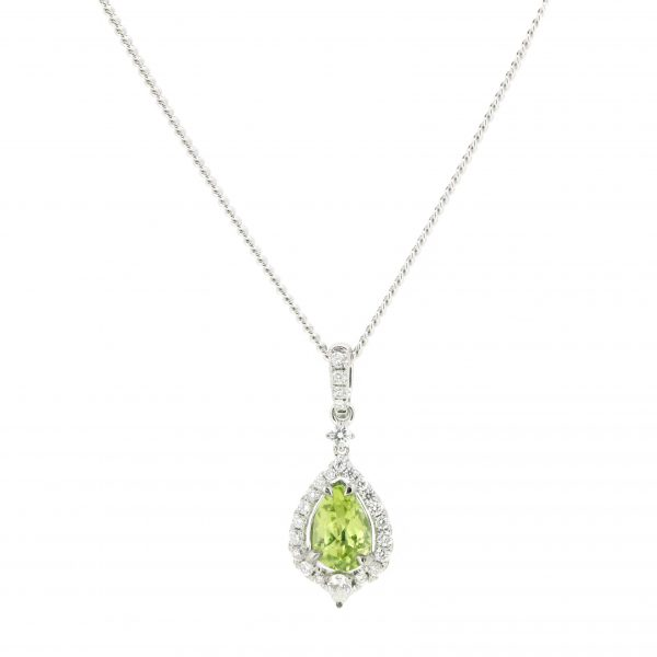 18ct White Gold, .77ct Peridot & .27ct of Diamonds.