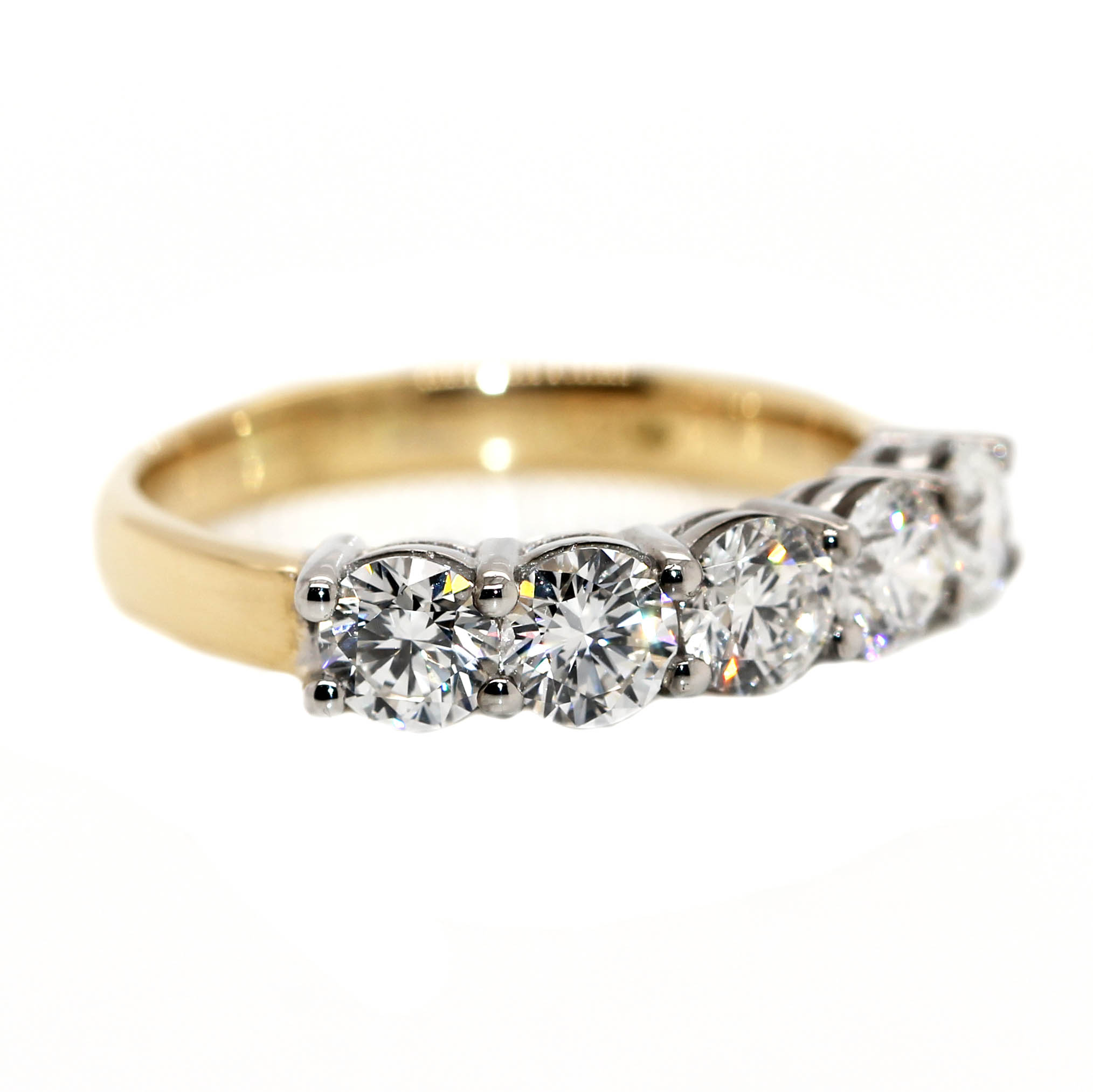 18ct Yellow Gold & Platinum, set with 5 Diamonds equaling 1.51ct of Diamonds.